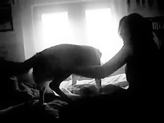 girl in the bedroom with dog
